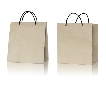 21970882 - brown paper bag on reflect floor and white background