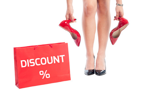 31743971 - woman shoes discount concept using red shoping paper bag and high heel female shoes